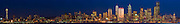 Panoramic skyline of Seattle in the early evening hours looking across Puget Sound.