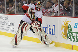 Apr 7; Newark, NJ, USA; Ottawa Senators goalie Craig Anderson (41) plays the puck during the first period of their game against the New Jersey Devils at the Prudential Center.