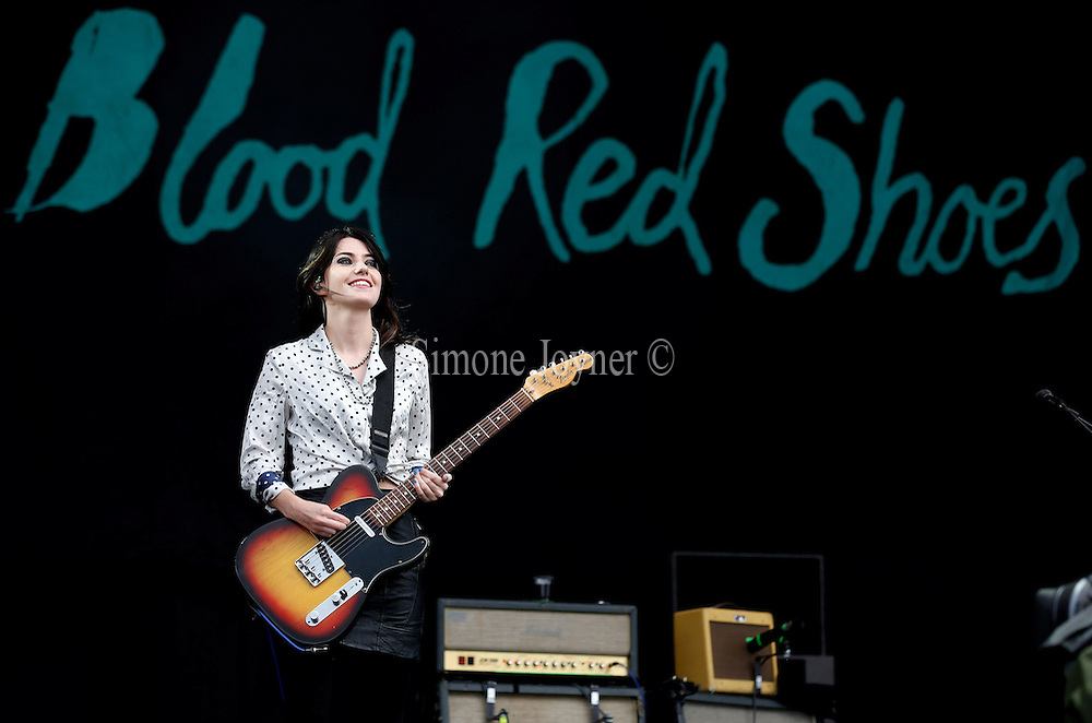 READING, ENGLAND - AUGUST 25:  Laura-Mary Carter of Blood Red Shoes performs live on the Main Stage on Day Two during the Reading Festival 2012 at Richfield Avenue on August 25, 2012 in Reading, England.  (Photo by Simone Joyner/Getty Images)