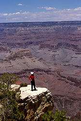 AZ, Arizona, Woman tourist, model released, at South Rim of Grand Canyon National Park, Arizona.Photo Copyright: Lee Foster, lee@fostertravel.com, www.fostertravel.com, (510) 549-2202.azgran217