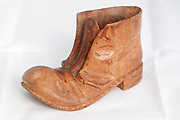 Hand crafted Wooden old boot on white background
