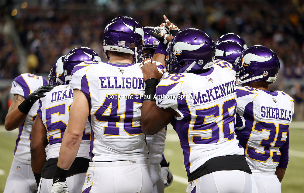 A group of Minnesota Vikings join hands during the NFL week 15 football game against the St. Louis Rams on Sunday, Dec. 16, 2012 in St. Louis. The Vikings won the game 36-22. ©Paul Anthony Spinelli