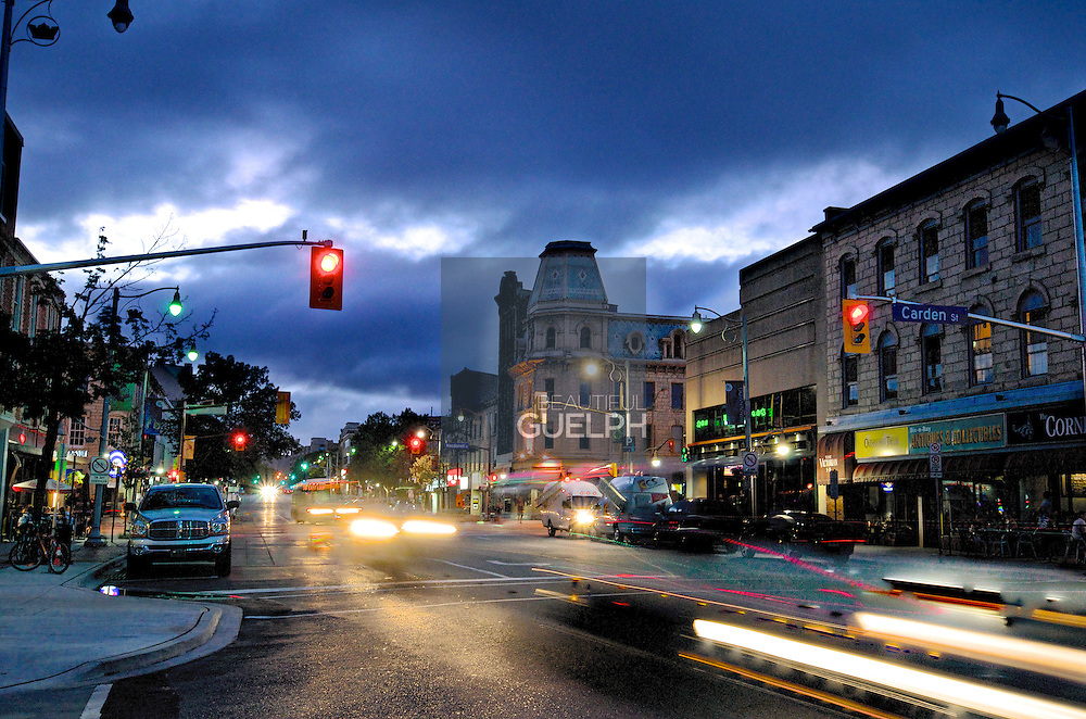 Corners of Carden and Wyndham at night, with a brooding sky.  Photo by Phil Maurion.