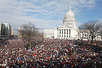 Massive crowds gather to see the 14 democratic senators that left the state to protest the bill proposed by the Gov. Scott Walker as crowds continue to protest at the Wisconsin State Capitol in Madison Wisconsin March 12, 2011.  photo by Darren Hauck