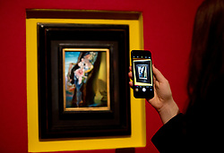 """© Licensed to London News Pictures. 22/02/2018. LONDON, UK. A visitor takes a picture with her phone of  """"Gradiva"""" (1931) by Salvador Dalí, with an estimate of £1,200,000 - 1,800,000, on display at Sotheby's photo call for highlights from their forthcoming sales of Impressionist, Modern, Surrealist and Contemporary Art. Photo credit: ISABEL INFANTES/LNP"""