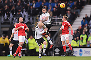Derby County midfielder Bradley Johnson (15) clashes with Derby County forward Johnny Russell (7) during the EFL Sky Bet Championship match between Derby County and Nottingham Forest at the iPro Stadium, Derby, England on 11 December 2016. Photo by Jon Hobley.