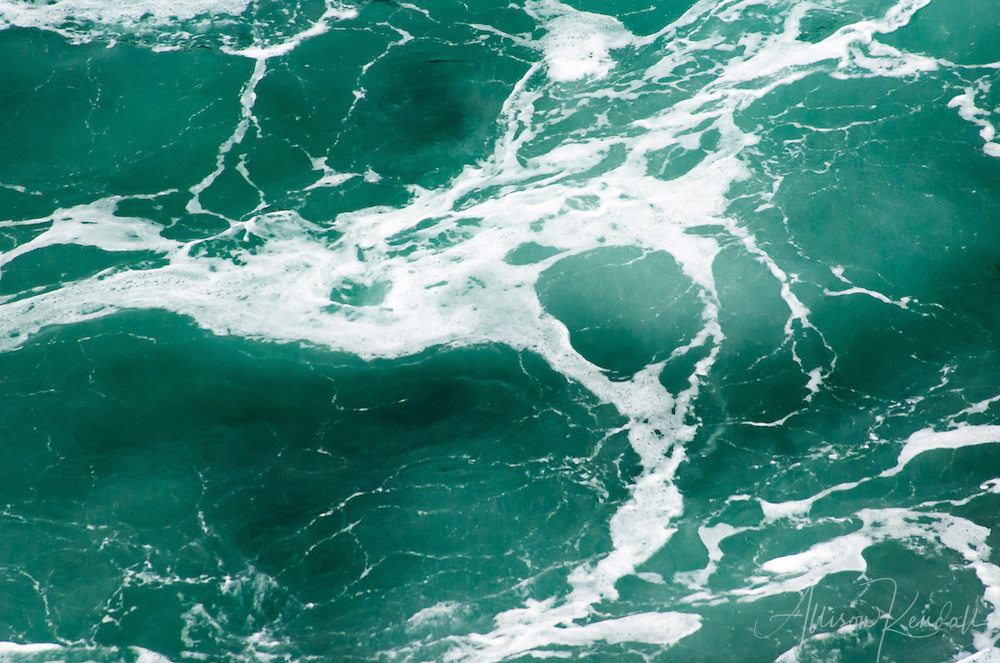 Aquamarine waves swell in the surf zone of Big Sur