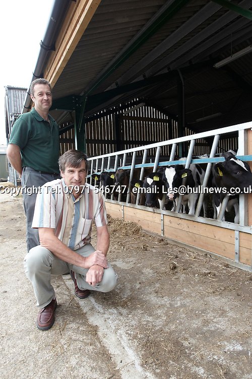 30th June 2014<br /> Colin Dennis and Phil Richardson (Green top) at the new cattle sheds, Bishop Burton College, East Yorkshire