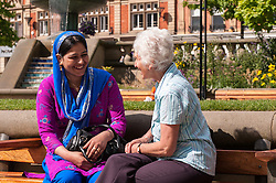 Two women talking as part of a Multi cultural mentoring scheme in Sheffield