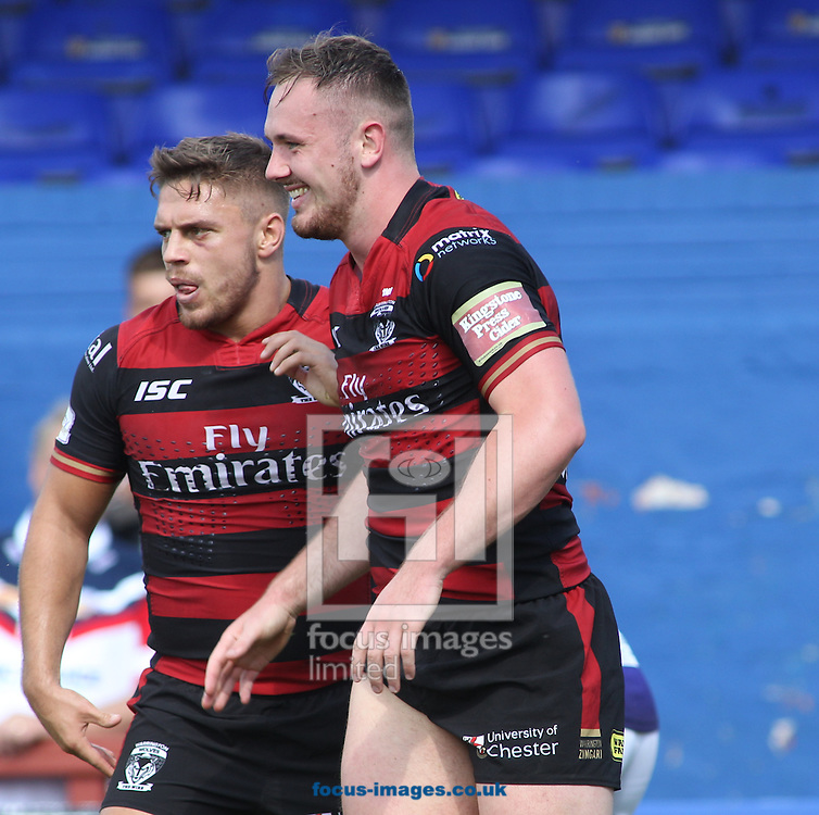 Ben Currie (R) of Warrington Wolves  celerbrates scoring the try with his team mates against Wakefield Trinity Wildcats during the Super 8s match at Belle Vue, Wakefield<br /> Picture by Stephen Gaunt/Focus Images Ltd +447904 833202<br /> 14/08/2016