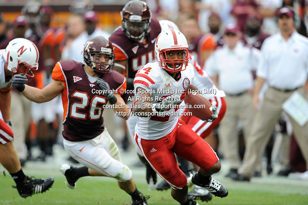19 September 2009: Nebraska wide receiver Niles Paul (24) gets chased by Virginia Tech linebacker Cody Grimm (26) during the Hokies 16-15 win over the Nebraska Huskers at Worsham Field at Lane Stadium in Blacksburg, VA