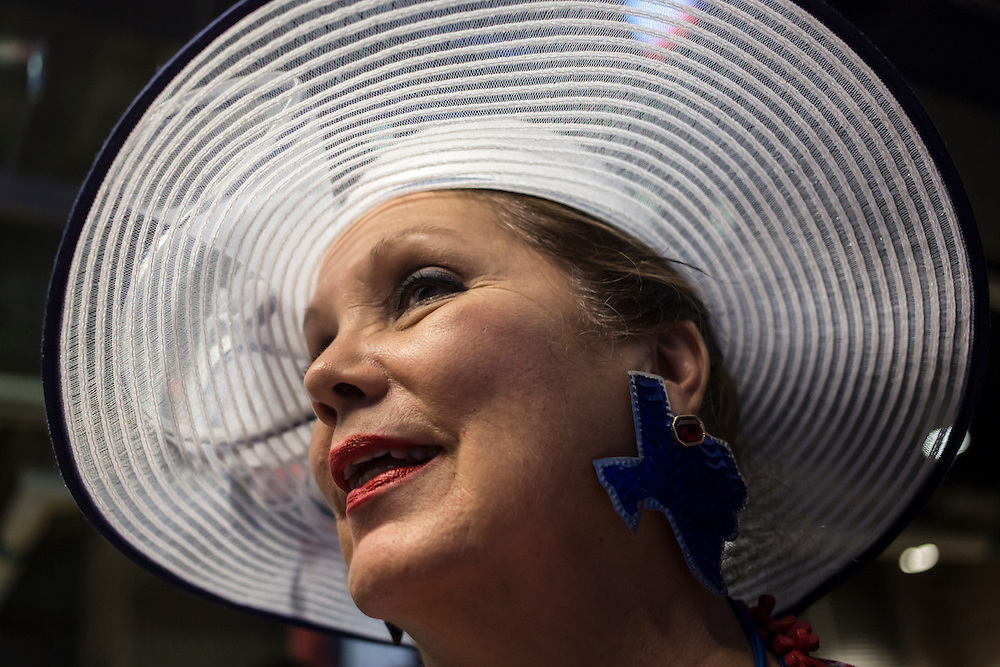 Verna Blackwell, a delegate from San Antonio, Texas, shows off her earrings on Tuesday, September 4, 2012 in Charlotte, NC.
