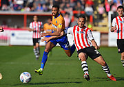 CJ Hamilton (22) of Mansfield Town battles for possession with Kane Wilson (20) of Exeter City during the EFL Sky Bet League 2 match between Exeter City and Mansfield Town at St James' Park, Exeter, England on 30 March 2019.