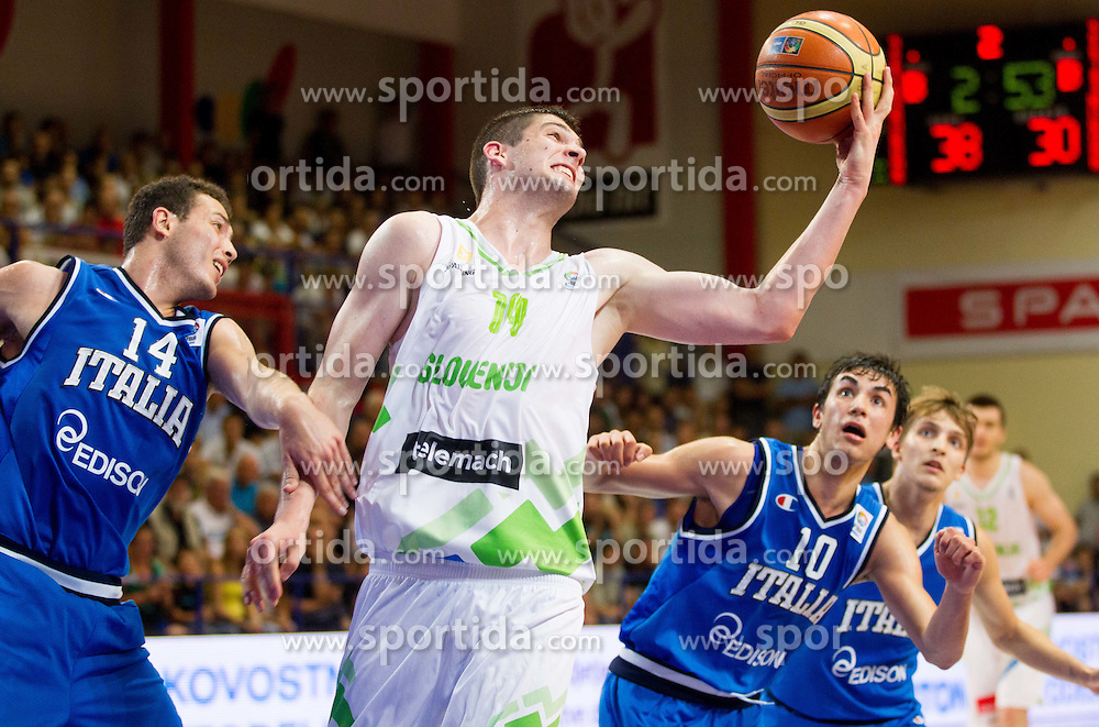 Ziga Dimec of Slovenia between Dario Cefarelli of Italy and Marco Lagana of Italy during basketball match between National team of Slovenia and Italy in First Round of U20 Men European Championship Slovenia 2012, on July 12, 2012 in Domzale, Slovenia.  (Photo by Vid Ponikvar / Sportida.com)