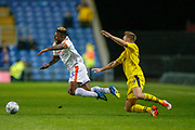 Oxford United defender Anthony McMahon (29) brings down Luton Town's Kazenga Lualua (25) during the EFL Sky Bet League 1 match between Oxford United and Luton Town at the Kassam Stadium, Oxford, England on 2 October 2018.