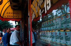 CZECH REPUBLIC PRAGUE JUL00 - A man enters a butcher store decorated with beer cans on Wenceslas Square in the centre of Prague.. . jre/Photo by Jiri Rezac.  . © Jiri Rezac 2000. . Tel:   +44 (0) 7050 110 417. Email: info@jirirezac.com. Web:   www.jirirezac.com