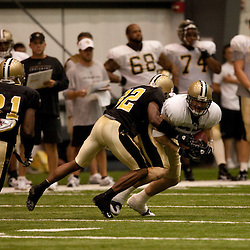 08 August 2009: tight end Jeremy Shockey (88) makes a catch in front of cornerback Jabari Greer (32) and Pierson Prioleau (31) during the New Orleans Saints annual training camp Black and Gold scrimmage held at the team's indoor practice facility in Metairie, Louisiana.