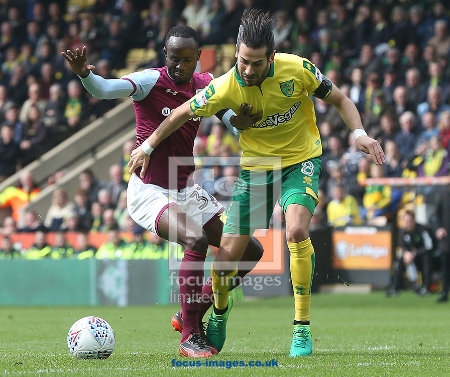 Albert Adomah of Aston Villa and Mario Vrancic of Norwich in action during the Sky Bet Championship match at Carrow Road, Norwich<br /> Picture by Paul Chesterton/Focus Images Ltd +44 7904 640267<br /> 07/04/2018