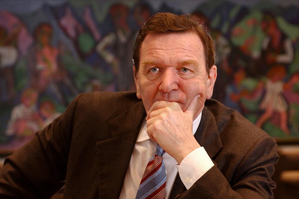 09 JAN 2002, BERLIN/GERMANY:<br /> Gerhard Schroeder, SPD, Bundeskanzler, waehrend einem Interiew, in seinem Buero, Bundeskanzleramt<br /> Gerhard Schroeder, SPD, Federal Chancellor of Germany, during an interview, in his office<br /> IMAGE: 20020109-02-024<br /> KEYWORDS: Gerhard Schröder