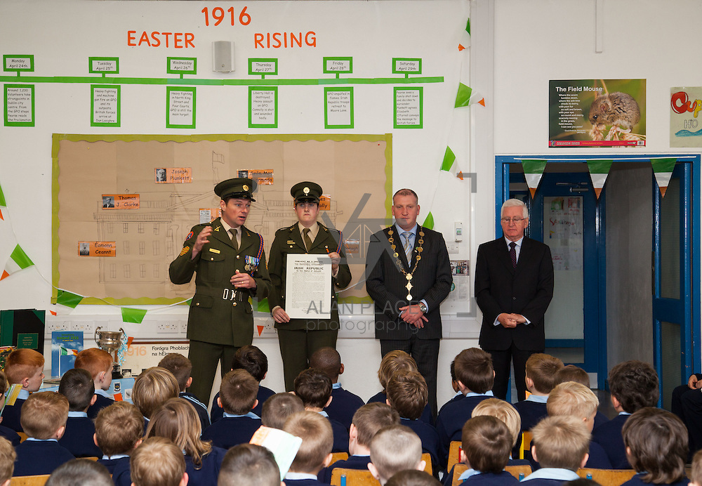 23/10/2015       <br /> Members of the Defence Forces were in Abbeyfeale today to present a handmade Tricolour and a copy of the Proclamation of the Irish Republic to students of the town's two primary schools.<br /> <br /> St Marys Boys National School and Scoil Mh&aacute;thair D&eacute; are among 3,000 schools nationally and 152 Limerick primary schools to receive the presentation as part of initiatives to mark the centenary of the 1916 Rising.&nbsp;<br /> <br /> Councillor Liam Galvin, Mayor of the City and County of Limerick joined pupils and teachers for today's presentation ceremony, which saw representatives of the Defences Forces raise the flag and read the Proclamation. <br /> <br /> Attending the ceremony at St. Marys Boys National School were, Sergeant James Reddan, Private Ciara Quinn, Mayor of Limerick Cllr. Liam Galvin and Con Daly, Chairman of The Board St. Marys BNS. Picture: Alan Place.