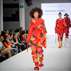 © Licensed to London News Pictures. 03/06/2018. LONDON, UK.  A model presents a look by Roshani Limbu from Solent University on the opening day of Graduate Fashion Week taking place at the Old Truman Brewery in East London.  The event presents the graduation show of up and coming fashion designers from UK and international universities.  Photo credit: Stephen Chung/LNP