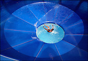 Arkansas Democrat-Gazette/BENJAMIN KRAIN 6-19-02<br /> A swimer falls through the drop hole after sliding around the new Vertigo water ride at Wild River Country Wednesday afternoon.