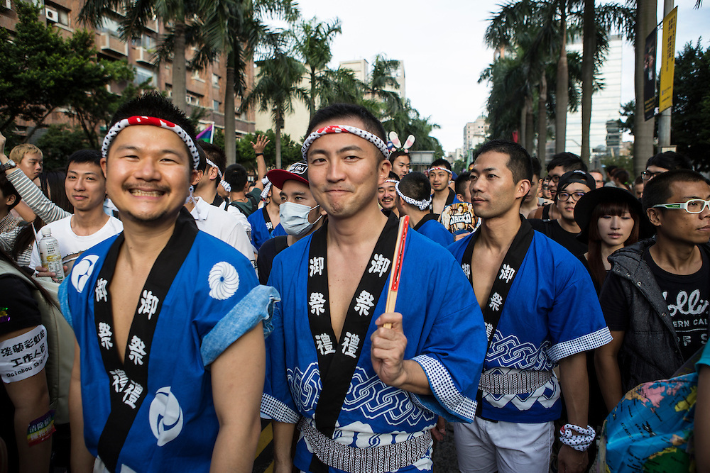 """All smiles from gay men wearign traditional Japanese clothing at Taipei Pride. The annual march through Taipei's city streets is the largest in Asia, with well over 50 000 people taking part. The 2014 event had the theme """"Walk in Queer's Shoes"""", to encourage the wider community to lend their support for equal marriage rights."""