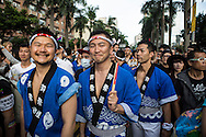 "All smiles from gay men wearign traditional Japanese clothing at Taipei Pride. The annual march through Taipei's city streets is the largest in Asia, with well over 50 000 people taking part. The 2014 event had the theme ""Walk in Queer's Shoes"", to encourage the wider community to lend their support for equal marriage rights."