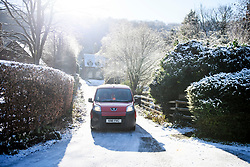 © Licensed to London News Pictures. 30/01/2019. Butlers Cross, UK.  A post van drives on icy roads through a snow covered scene near Butlers Cross, Buckinghamshire, as snow hits the south east of England. Photo credit: Ben Cawthra/LNP
