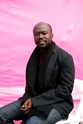 Dec 03 2007. New Orleans, Louisiana. Lower 9th Ward.<br /> Brad Pitt revisits the Lower 9th ward, devastated by Hurricane Katrina to present 'Make it Right' where architects' designs are unveiled to the public. One of the winning design Architects, David Adjaye of Adjaye Associates of London with a pink background for the pink project.<br /> Photo credit; Charlie Varley.