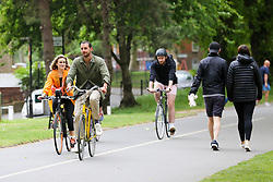 © Licensed to London News Pictures. 10/05/2020. London, UK. Cyclists in London Fields park in Hackney, north London, during lockdown. Grant Shapps, Transport Secretary announced that the government wanted more people to cycle when the coronavirus lockdown is eased. <br /> Later today, Prime Minister Boris Johnson is set to announce measures to ease the coronavirus lockdown, which was introduced on 23 March to slow the spread of the COVID-19. Photo credit: Dinendra Haria/LNP