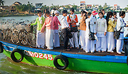 Highschool students dressed on ao dai on a boat in Hoi An (Vietnam)
