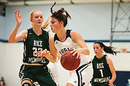 Mount Mansfield forward Perry Willett (5) drives to the hoop past Rice forward Lizzy Lyman (22) during the girls basketball game between the Rice Green knights and the Mount Mansfield Cougars at MMU High School on Friday night December 4, 2015 in Jericho. (BRIAN JENKINS/for the FREE PRESS)
