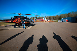 CANADA ALBERTA FORT MCMURRAY 10MAY07 - Phoenix Heliflight preparations before take-off from Fort McMurray, Alberta, Canada. The Alberta Tar Sands are the largest deposits of their kind in the world and their production is the single largest contributor to Canada's greenhouse gas emissions...Alberta's tar sands are currently estimated to contain a crude bitumen resource of 315 billion barrels, with remaining established reserves of almost 174 billion barrels, thus making Canada's oil resources ranked second largest in the world in terms of size...The industry has brought wealth and an economic boom to the region but also created an environmental disaster downstream from the Athabasca river, polluting the lakes where water and fish are contaminated. The native Indian tribes of the Mikisew, Cree, Dene and other smaller First Nations are seeing their natural habitat destroyed and are largely powerless to stop or slow down the rapid expansion of the oil sands development, Canada's number one economic driver...jre/Photo by Jiri Rezac / WWF-UK..© Jiri Rezac 2007..Contact: +44 (0) 7050 110 417.Mobile: +44 (0) 7801 337 683.Office: +44 (0) 20 8968 9635..Email: jiri@jirirezac.com.Web: www.jirirezac.com..© All images Jiri Rezac 2007 - All rights reserved.