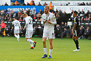 Oli McBurnie (9) of Swansea City complains to the assistant referee that John O'Shea (4) of Reading pulled and ripped his shirt during the EFL Sky Bet Championship match between Swansea City and Reading at the Liberty Stadium, Swansea, Wales on 27 October 2018.