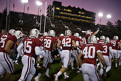 November 28, 2009; Stanford, CA, USA;  Stanford Cardinal linebacker Will Powers (42) and safety Harold Bernard (28) and quarterback Alex Loukas (15) and safety Taylor Skaufel (40) enter Stanford Stadium before the game against the Notre Dame Fighting Irish.  Stanford defeated Notre Dame 45-38.