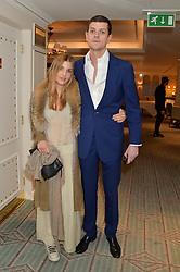 SCARLETT STRUTT and the HON.ALEXANDER SPENCER-CHURHILL at the launch of Mrs Alice in Her Palace - a fashion retail website, held at Fortnum & Mason, Piccadilly, London on 27th March 2014.