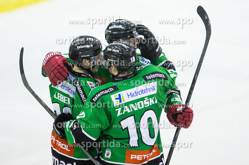 25.01.2015, Hala Tivoli, Ljubljana, SLO, EBEL, HDD Telemach Olimpija Ljubljana vs EHC Liwest Linz, 43. Runde, in picture Tom Zanoski (HDD Telemach Olimpija, #10) and other players of Olimpija celebrate during the Erste Bank Icehockey League 43. Round between HDD Telemach Olimpija Ljubljana and EHC Liwest Linz at the Hala Tivoli, Ljubljana, Slovenia on 2015/01/25. Photo by Vid Ponikvar / Sportida