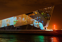 A film telling the story of leading artist Richard Wilson's Slipstream sculpture projected onto the side of The Deep, Hull, East Yorkshire, UK, October 31, 2013