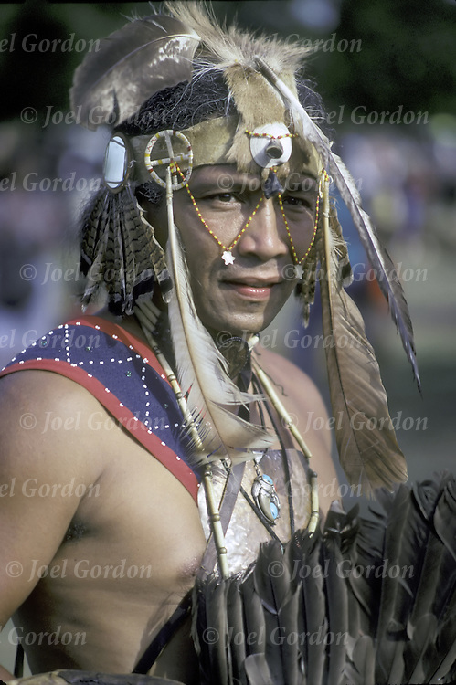 East Coast Native-African American @ Thunderbird powwow  dressed in traditional regalia in Queens, NY .<br /> <br /> A pow-wow (also powwow or pow wow or pau wau) is a gathering of North America's Native people. The word derives from the Narragansett word powwaw, meaning &quot;spiritual leader&quot;.