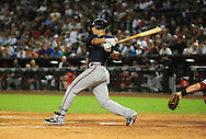 May 19 2011; Phoenix, AZ, USA; Atlanta Braves batter Martin Prado (14) grounds out during the eighth inning against the Arizona Diamondbacks at Chase Field. The Diamondbacks defeated the Braves 2-1. Mandatory Credit: Jennifer Stewart-US PRESSWIRE..