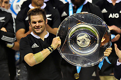 New Zealand captain Richie McCaw lifts the Hillary Shield in celebration after the match - Photo mandatory by-line: Patrick Khachfe/JMP - Tel: Mobile: 07966 386802 16/11/2013 - SPORT - RUGBY UNION -  Twickenham Stadium, London - England v New Zealand - QBE Autumn Internationals.