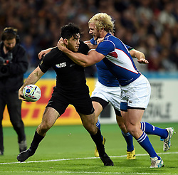 Nehe Milner-Skudder of New Zealand is tackled in possession - Mandatory byline: Patrick Khachfe/JMP - 07966 386802 - 24/09/2015 - RUGBY UNION - The Stadium, Queen Elizabeth Olympic Park - London, England - New Zealand v Namibia - Rugby World Cup 2015 Pool C.