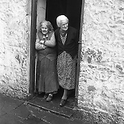 Mrs. Bridget O'Riordan and Mrs. Mary Kelly standing at the door of their rooms at the Corporation Widows Alms House, Limerick..28.03.1962