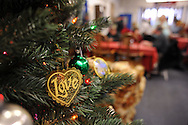 LEVITTOWN, PA -  DECEMBER 15: An ornament hangs from a Christmas tree during a holiday dinner for former homeless veterans hosted by the Jewish War Veterans of America - Bristol and partnered with the Levittown Disabled American Veterans - Post 117 December 15, 2013 in Levittown, Pennsylvania. (Photo by William Thomas Cain/Cain Images)