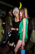 Lucy Ferry and Lady Eloise Anson, Tanqueray Philip Treacy couture fashion show and after party,  Pink Paradise Club, Paris. 21 January 2003. © Copyright Photograph by Dafydd Jones 66 Stockwell Park Rd. London SW9 0DA Tel 020 7733 0108 www.dafjones.com