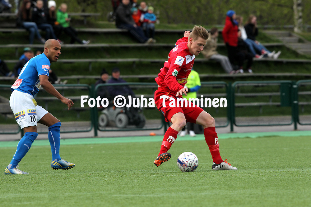 26.5.2014, Keskuskentt&auml;, Rovaniemi.<br /> Veikkausliiga 2014.<br /> Rovaniemen Palloseura - FF Jaro.<br /> Ilya Vaganov (Jaro) v Nicholas Otaru (RoPS).