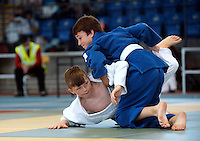 21 Aug 2016:  Liam Murphy, Galway (blue suit white belt), in action against JAcke O'Riordan, Limerick (white suit/blue belt).  Judo Boys 40kg.  2016 Community Games National Festival 2016.  Athlone Institute of Technology, Athlone, Co. Westmeath. Picture: Caroline Quinn