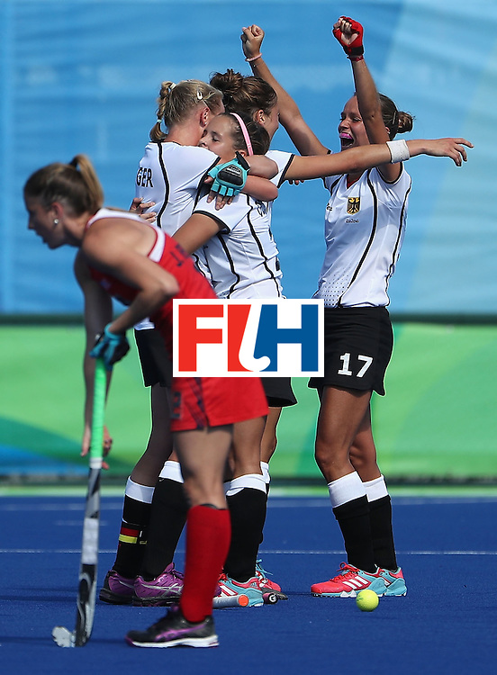 RIO DE JANEIRO, BRAZIL - AUGUST 15:  Jana Teschke #17 (R) of  Germany celebrates with teammates after defeating United States 2-1 in the quarter final hockey game on Day 10 of the Rio 2016 Olympic Games at the Olympic Hockey Centre on August 15, 2016 in Rio de Janeiro, Brazil.  (Photo by Christian Petersen/Getty Images)