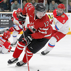 TRENTON, - Dec 10, 2015 -  Exhibition Game 3-  Russia vs Team Canada West at the 2015 World Junior A Challenge at the Duncan Memorial Gardens, ON. Bobby McMann #12 of Team Canada West skates with the puck during the second period (Photo: Amy Deroche / OJHL Images)